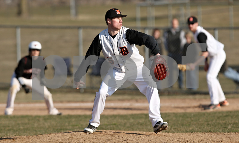 Rob Winner – rwinner@daily-chronicle.com<br /> <br /> DeKalb's Jake Gordon delivers a pitch in the fifth inning on Wednesday, March 30, 2011 in DeKalb, Ill. Huntley defeated DeKalb, 11-8.