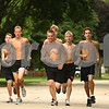 Kyle Bursaw – kbursaw@daily-chronicle.com<br /> <br /> Some of the DeKalb boys cross country team, including Marc Dubrick (third from left), runs on West Royal Drive during practice on Friday, Aug. 12, 2011.