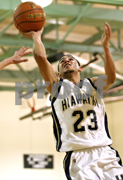 Rob Winner – rwinner@daily-chronicle.com<br /> <br /> Hiawatha's Jeo Andujar (23) puts up two during the second quarter of the Hawks' Little Ten tournament game in Somonauk, Ill., on Monday, January 31, 2011. Paw Paw defeated Hiawatha, 68-65.