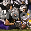 Rob Winner – rwinner@shawmedia.com<br /> <br /> Kaneland's Sean Carter (25) nearly recovers a fumble during Belvidere's first drive in the first quarter of their game in Maple Park on Friday, Oct. 28, 2011.