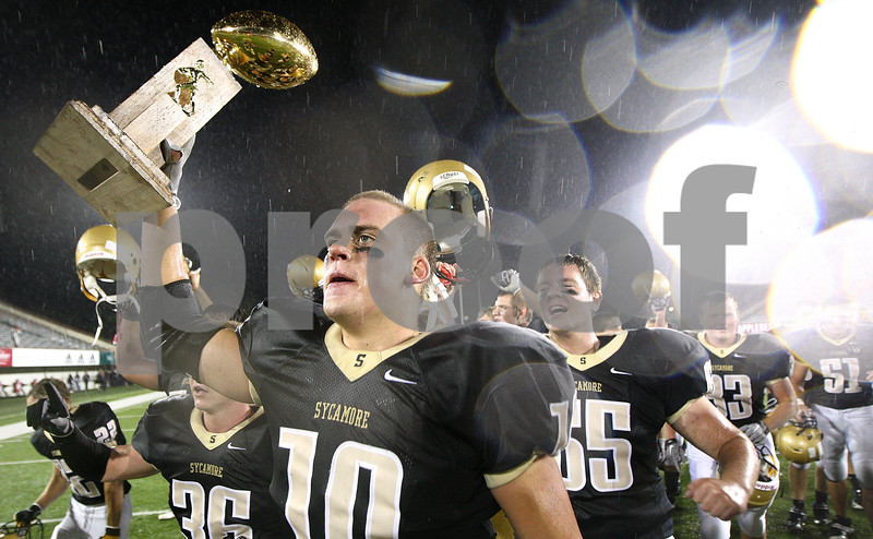 Kyle Bursaw – kbursaw@shawmedia.com<br /> <br /> Sycamore's Jordan Kalk carries the trophy to their fan section after beating DeKalb 33-22 in their annual matchup at Huskie Stadium in DeKalb, Ill. on Friday, September 9, 2011.