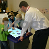 Jeff Engelhardt  jengelhardt@shawmedia.com<br /> North Grove Elementary students Finn Doyle (left), Lauren Cohn (center) and Sam Krull (right) use a SMART Table Wednesday as Principal Ryan Janisch looks on. Janisch presented a $7,000 grant that will go toward purchasing a SMART Board and SMART Table to the first-grade classes. The grant was given by the Monsanto Fund, the philanthropic branch of the Monsanto Company. Janisch said up to four students could work on the SMART Table at one time and it will give first-graders the opportunity to learn in a hands-on fashion.
