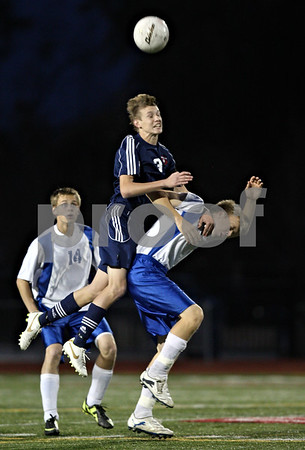 Rob Winner – rwinner@shawmedia.com<br /> <br /> Lisle's Eric Osika (3) and Hinckley-Big Rock's Jared Madden try to control a ball during the first half of a Class 1A Naperville Central Super Sectional on Tuesday, October 25, 2011.