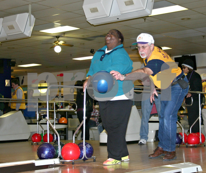 Sycamore Lions Club member Ed Kuhn helps Denise Gibbs of Chicago line up her bowling ball at Four Seasons Sports in Sycamore Sunday. Gibbs was one of 80 visually-impaired participants who attended the Skiing for Sight retreat in DeKalb this weekend.