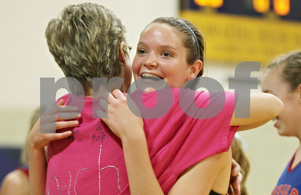 Rob Winner – rwinner@shawmedia.com<br /> <br /> Hinckley-Big Rock assistant coach Joanne Weirich (left) hugs Beth Klein after a block by Klein led to an H-BR point and a Somonauk timeout during the second game in Kirkland on Thursday, Oct. 6, 2011. H-BR defeated Somonauk, 25-19 and 25-16. H-BR will face Newark for the Little 10 tournament title on Friday.