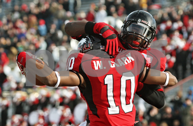 Rob Winner – rwinner@shawmedia.com<br /> <br /> Northern Illinois wide receiver Willie Clark (10) celebrates his touchdown reception with teammate Martel Moore during the first quarter in DeKalb, Ill. on Friday, Nov. 25, 2011. Northern Illinois defeated Eastern Michigan, 18-12.