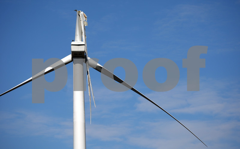 Rob Winner – rwinner@daily-chronicle.com<br /> <br /> A broken blade can be seen hanging from a wind turbine near the intersection of Shabbona and Gurler roads in Milan Township on Tuesday, March 29, 2011.