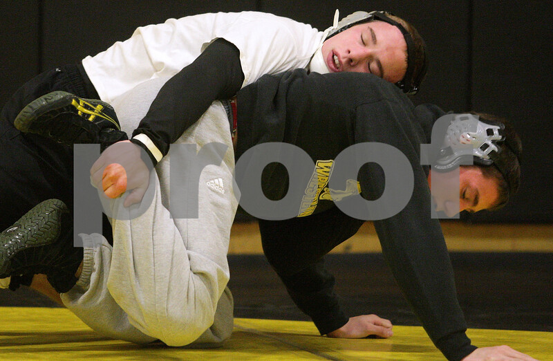 Kyle Bursaw – kbursaw@daily-chronicle.com<br /> <br /> Sycamore's Austin Coulton grabs hold of teammate Tom Ernster during practice on Tuesday, Dec. 28, 2010 at Sycamore high school.