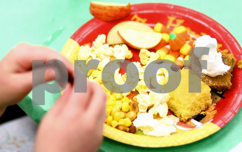 Kyle Bursaw – kbursaw@shawmedia.com<br /> <br /> Davenport Elementary kindergarten classes partook in a Thanksgiving 'feast' including corn, cornbread, candy corn, popcorn, corn nuts, pumpkin pie, jerky, apples and sweet potatoes on Tuesday, Nov. 22, 2011.