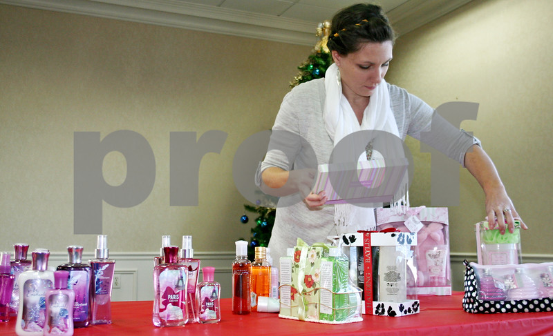 """Nicole Weskenra – nweskerna@shawmedia.com<br /> <br /> Brenna Hale of Madison, Wisc., helps sort gifts for the second annual """"Joy is in the Giving"""" event being held today by the DeKalb Rotary Club at the Ellwood House Visitors' Center. The organization purchased gifts and will allow kids from Hope Haven and Safe Passage to """"shop"""" for Christimas gifts to give to their mothers."""