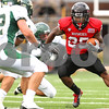 Kyle Bursaw – kbursaw@shawmedia.com<br /> <br /> Northern Illinois running back Jasmin Hopkins (25) changes direction as he approaches Cal Poly defenders  during the second quarter of the game at Huskie Stadium in DeKalb, Ill. on Saturday, Sept. 24, 2011.