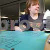 Kyle Bursaw – kbursaw@daily-chronicle.com<br /> <br /> PRISM member Samantha Johnson decorates a birthday card for the group to celebrate its 41st anniversary at NIU. The card was on display for anyone to sign at the Holmes Student Center at NIU on Wednesday, April 13, 2011.