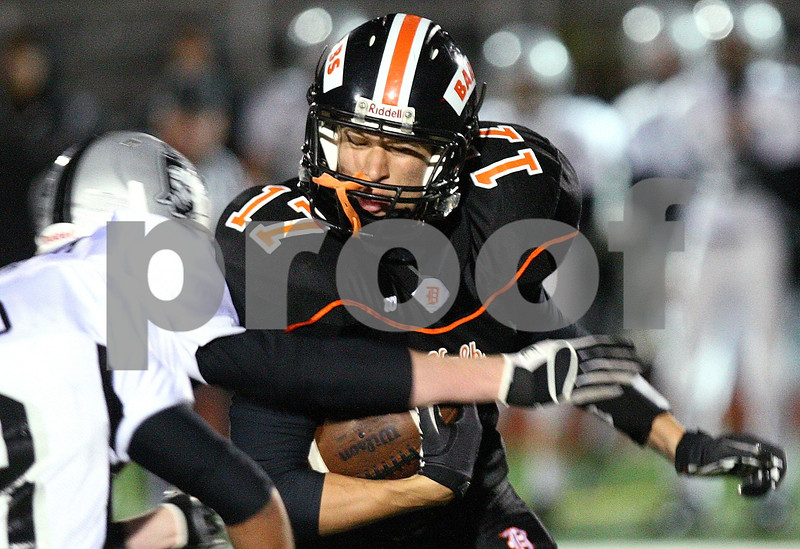 Kyle Bursaw – kbursaw@shawmedia.com<br /> <br /> DeKalb tight end Jake Carpenter pushes for more yards as a Kaneland defender starts to wrap him up in the first half of the game in DeKalb, Ill. on Friday, Sept. 30, 2011.