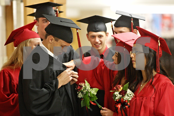Rob Winner – rwinner@daily-chronicle.com<br /> <br /> Jordan Nelson (left) receives some help from fellow graduating senior Karissa Paku before entering the gymnasium for the Indian Creek High School commencement on Sunday, May 15, 2011, in Shabbona, Ill.