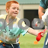 Kyle Bursaw – kbursaw@daily-chronicle.com<br /> <br /> Silas Eschbach grabs hold of the flag of another student at the Vacation Bible School during a round of flag tag outside the Cornerstone Christian Academy on Wednesday, June 15, 2011.
