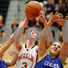 Rob Winner – rwinner@shawmedia.com<br /> <br /> While trying to control a rebound, DeKalb's Courtney Bemis (3) is fouled by Central's Catherine Kaynish (left) as Jo Jo DeSantis (right) assists on the play during the first quarter in DeKalb, Ill., on Tuesday, Dec. 6, 2011.