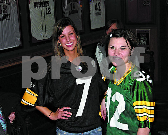 Steeler fan Britni Speich, left, and Packer fan Mallory Kapitanoff proudly sported their team colors at Fatty's before Super Bowl XLV kicked off on Sunday.
