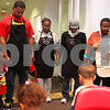 Kyle Bursaw – kbursaw@shawmedia.com<br /> <br /> Members of New Hope Missionary Baptist Church join hands in prayer Thursday morning before working to distribute a Thanksgiving meal on Thursday, Nov. 24, 2011 in DeKalb, Ill.