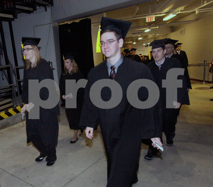 Wendy Kemp - For The Daily Chronicle<br /> The processional begins at the graduation ceremony at Northern Illinois University on Sunday.<br /> DeKalb 12/11/11