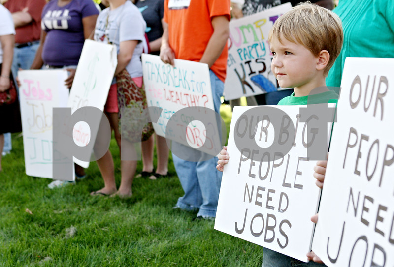 Rob Winner – rwinner@daily-chronicle.com<br /> <br /> 5-year-old Blake Wiegartz, of Kirkland, holds up a sign while attending the Rally for the American Dream with his grandfather Bill Weiss (not pictured) at DeKalb Square near the corner of Fourth Street and Lincoln Highway on Wednesday afternoon. Approximately 80 people showed up for the rally from all over the county.
