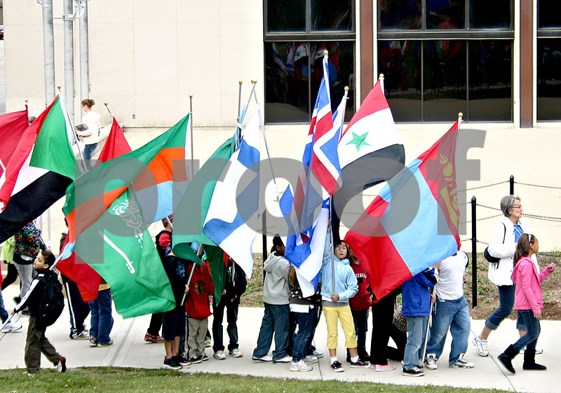 More than 200 international flags were set up at Northern Illinois University's MLK Commons Friday for the 12th annual Parade of Flags. The flags were carried to the commons area by fifth graders in DeKalb District 428.<br /> <br /> By NICOLE WESKERNA - nweskerna@shawmedia.com