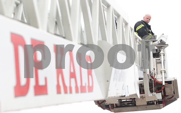 Kyle Bursaw – kbursaw@daily-chronicle.com<br /> <br /> DeKalb firefighter Jason Pavlak operates the department's ladder truck, which is now more than 20 years old, during a maintenance check on Wednesday, April 6, 2011 at Station no. 1 in DeKalb, Ill.
