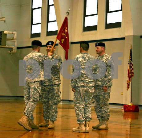 Capt. Daniel Smiljanich (second from left) participates in a change of command ceremony Saturday afternoon at the Sycamore Armory Building. Smiljanich was commander fof the Alpha Battery, 2nd Battalion of the 122nd Field Artillery for nearly two years. Capt. Dustin Cammack took over as commander.<br /> <br /> By NICOLE WESKERNA - nweskerna@shawmedia.com