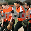 Rob Winner – rwinner@daily-chronicle.com<br /> <br /> DeKalb pitcher Katie Kowalski (1) leaves the field with her teammates after defeating Sycamore, 4-3, on Tuesday, April 5, 2011, in DeKalb, Ill.