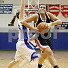 Rob Winner – rwinner@daily-chronicle.com<br /> <br /> Hinckley-Big Rock's Alyssa Baunach (left) defends DeKalb's Kelli Gerace during the second quarter.