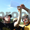 Kyle Bursaw – kbursaw@daily-chronicle.com<br /> <br /> Coach Travis Kalk (left) and quarterback Ryan Bartels look at a play Kalk called for the offense during the first day of football practice Wednesday morning at Sycamore High School.<br /> <br /> Wednesday, Aug. 10, 2011.