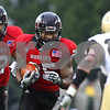 Kyle Bursaw – kbursaw@shawmedia.com<br /> <br /> Northern Illinois running back Jasmin Hopkins (25) looks for a lane after taking a handoff from Northern Illinois quarterback Chandler Harnish (12)  during the first quarter of the game against Army at Huskie Stadium in DeKalb, Ill. on Saturday, Sept. 3, 2011.