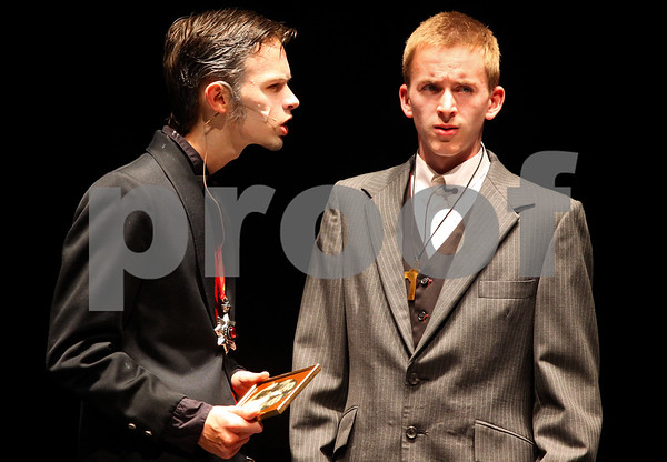 Kyle Bursaw – kbursaw@shawmedia.com<br /> <br /> Count Dracula, played by Derek Neff (left), talks to Jonathan Harker, played by  Dalton Bates, about his wife Mina during a dress rehearsal of Dracula at DeKalb High School on Monday, Oct. 31, 2011.
