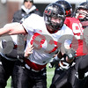 Kyle Bursaw – kbursaw@daily-chronicle.com<br /> <br /> Jason Schepler heads upfield to block a defender during practice at Huskie Stadium on Saturday, March 26, 2011.