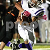 Kyle Bursaw – kbursaw@shawmedia.com<br /> <br /> Rochelle running back Kane Rodriguez fights for more yards as DeKalb linebacker Ryan Metsker gets a hand on him in the second quarter of the game at DeKalb High School on Friday, Oct. 21, 2011.