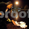 "Kyle Bursaw – kbursaw@shawmedia.com<br /> <br /> Jacky Lopez, president of Huskies United, guides a few stalled lanterns towards the center of the East Lagoon during a memorial ceremony for Antinette ""Toni"" Keller in DeKalb, Ill. on Tuesday, Oct. 18, 2011."
