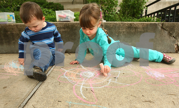 Kyle Bursaw – kbursaw@daily-chronicle.com<br /> <br /> Siblings Bryson and Ava Jontz draw with sidewalk chalk outside the DeKalb Public Library during one of the library's many summer events for children on Saturday, June 11, 2011.