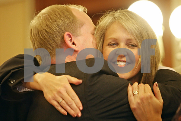 Rob Winner – rwinner@shawmedia.com<br /> <br /> Marcy Buick is hugged and kissed by her husband Kevin before being sworn in as an associate judge for the 16th Judicial Circuit at the DeKalb County Courthouse in Sycamore on Wednesday, Sept. 28, 2011. Buick fills the open position because of the death of T. Jordan Gallagher in June.