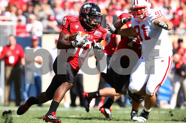 Kyle Bursaw – kbursaw@shawmedia.com<br /> <br /> Northern Illinois running back Akeem Daniels (30) looks for room to run during the second quarter of the game against Wisconsin at Soldier Field in Chicago, Ill. on  Saturday, September 17, 2011. Wisconsin defeated Northern Illinois 49-7.