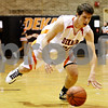 Rob Winner – rwinner@daily-chronicle.com<br /> <br /> DeKalb forward Jake Carpenter tries to control the ball after a near turnover in the second quarter in DeKalb, Ill. on Friday, Jan. 14, 2011.