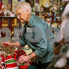 Kyle Bursaw – kbursaw@shawmedia.com<br /> <br /> Mina Johnson adjusts a display in the gift shop at Kishwaukee Community Hospital, where she's been volunteering for more than 14 years, on Thursday, Dec. 15, 2011.