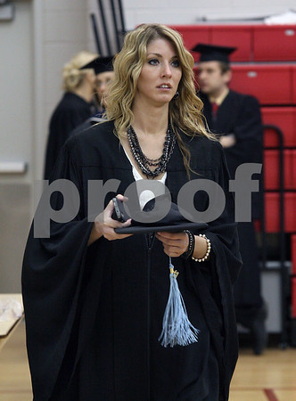 Wendy Kemp - For The Daily Chronicle<br /> Kendell Hunter arrives for the graduation ceremony at Northern Illinois University on Sunday.<br /> DeKalb 12/11/11