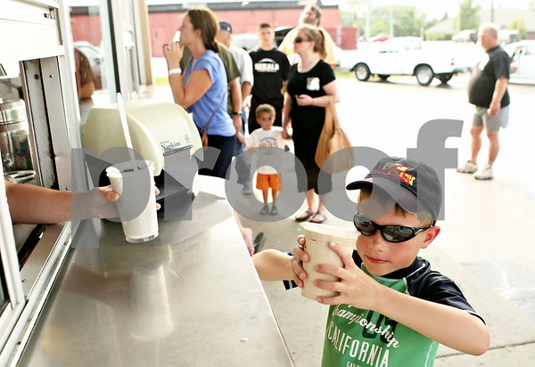 Rob Winner – rwinner@daily-chronicle.com<br /> <br /> Sycamore resident Ethan Fischer, 6, carefully picks up his hot fudge shake at Ollie's Frozen Custard on Wednesday afternoon.