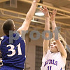 Kyle Bursaw – kbursaw@daily-chronicle.com<br /> <br /> Newark's John Avery blocks the shot of Hinckley-Big Rock's Michael Bayler in the first quarter in Hinckley, Ill. on Friday, Feb. 11, 2011.