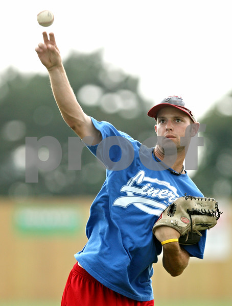 Rob Winner – rwinner@daily-chronicle.com<br /> <br /> Alex Beckmann of the DeKalb County Liners tosses a ball while playing catch before a game on Tuesday night in Sycamore.