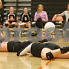 Rob Winner – rwinner@shawmedia.com<br /> <br /> DeKalb's Emily Bemis (left) and Madison Lord are unable to save a ball during the second game against Kaneland in DeKalb on Thursday, Sept. 15, 2011. DeKalb defeated Kaneland, 25-17 and 28-26.