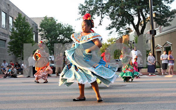 Rob Winner – rwinner@daily-chronicle.com<br /> <br /> Mercedes Oviedo, 12, performs with her dance group Rayitos del Sol of Conexion Comunidad as the Kishwaukee Fest Parade travels west on Lincoln Highway in downtown DeKalb on Friday evening.