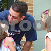 Kyle Bursaw – kbursaw@daily-chronicle.com<br /> <br /> Tony Feitlich says goodbye to his daughters Paige (left) and Molly Feitlich, in front of Waterman Elementary on the first day of school.<br /> <br /> Friday, Aug. 12, 2011.