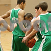 Rob Winner – rwinner@shawmedia.com<br /> <br /> Sycamore guard Rashaud Bomar (center) is called for traveling while trying to move the ball past three Geneseo defenders during the first quarter in DeKalb, Ill., at the Chuck Dayton Tournament on Wednesday, Dec. 28, 2011. Geneseo defeated Sycamore, 31-26.