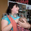 Curtis Clegg - cclegg@shawsuburban.com<br /> <br /> Nichole Eidsmoe of DeKalb, Illinois breast feeds her 11 month-old daughter Izrael Ehle in front of the No Strings Attached resale shop in DeKalb on Thursday, June 2, 2011.  Eidmoe claims that she was asked to leave the business on Tuesday by the shop's owner, John Rapp.