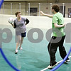 Rob Winner – rwinner@shawmedia.com<br /> <br /> Allison Sutton (left), a chaser, looks to throw a ball through a hoop past teammate Neal Heatherly, the keeper, during a Northern Illinois University Quidditch team practice at the Chick Evans Field House in DeKalb, Ill., on Wednesday, Sept. 21, 2011. Both Sutton and Heatherly kept one hand behind their back to simulate holding a broom during the warmup exercise.